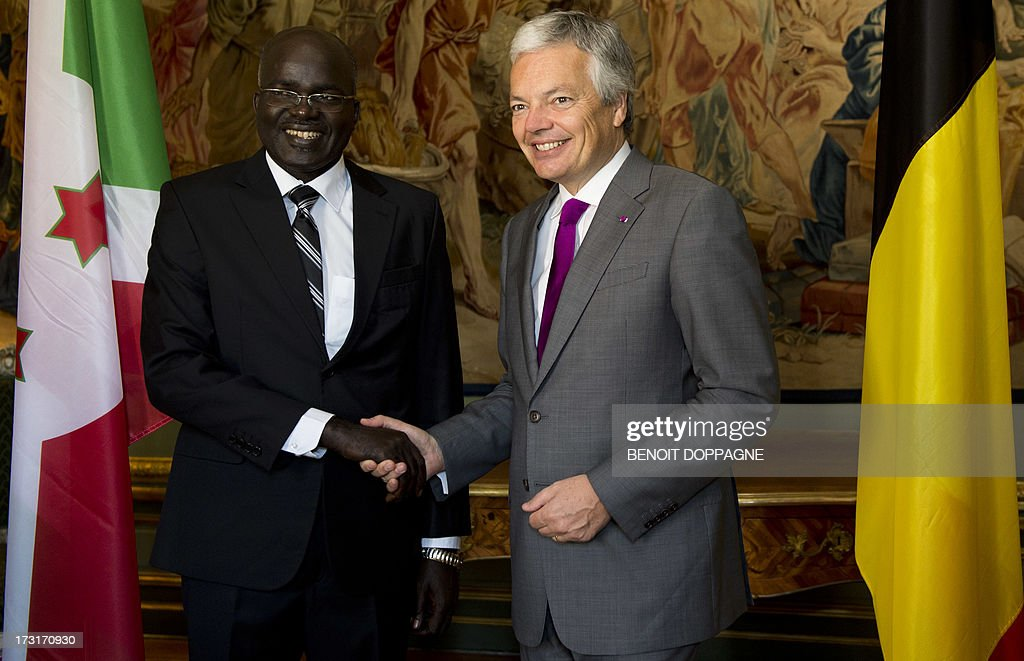 Belgian Foreign Minister Didier Reynders shakes hands with Burundi's Second Vice President Gervais Rufyikiri prior a bilateral meeting, at the Egmont Palace in Brussels on July 9, 2013. AFP PHOTO / BELGA - BENOIT DOPPAGNE