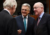 Belgian Foreign Minister Didier Reynders speaks with his Finnish counterpart Erkki Tuomioja and Irish counterpart Charlie Flanagan during an EU...