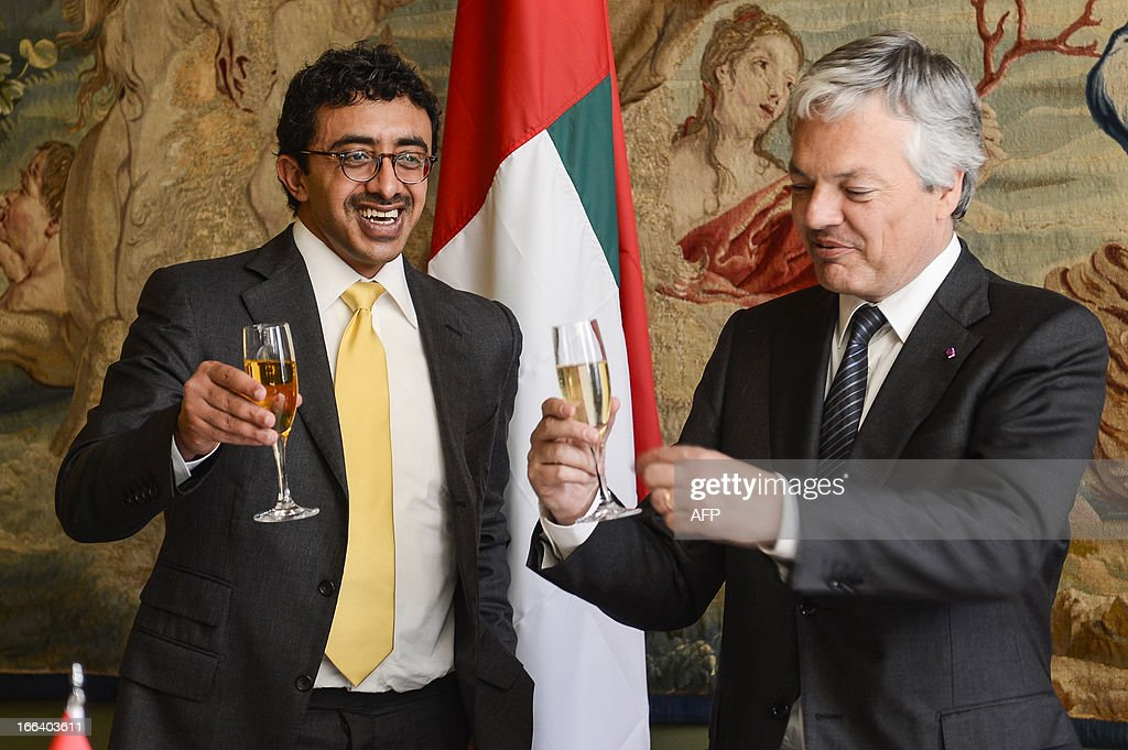 Belgian Foreign Minister Didier Reynders (L) toasts with United Arab Emirates' Foreign Minister Sheikh Abdullah bin Zayed al-Nahyan, at the Egmont Palace in Brussels on April 12, 2013. AFP PHOTO / BELGA / LAURIE DIEFFEMBACQ
