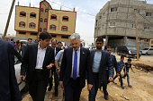 Belgian Foreign Minister Didier Reynders visits the eastern Gaza City Shujaiya neighbourhood which was destroyed during the 50day war between Israel...
