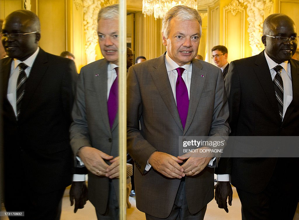 Belgian Foreign Minister Didier Reynders welcomes Burundi's Second Vice President Gervais Rufyikiri prior a bilateral meeting, at the Egmont Palace in Brussels on July 9, 2013. AFP PHOTO / BELGA - BENOIT DOPPAGNE