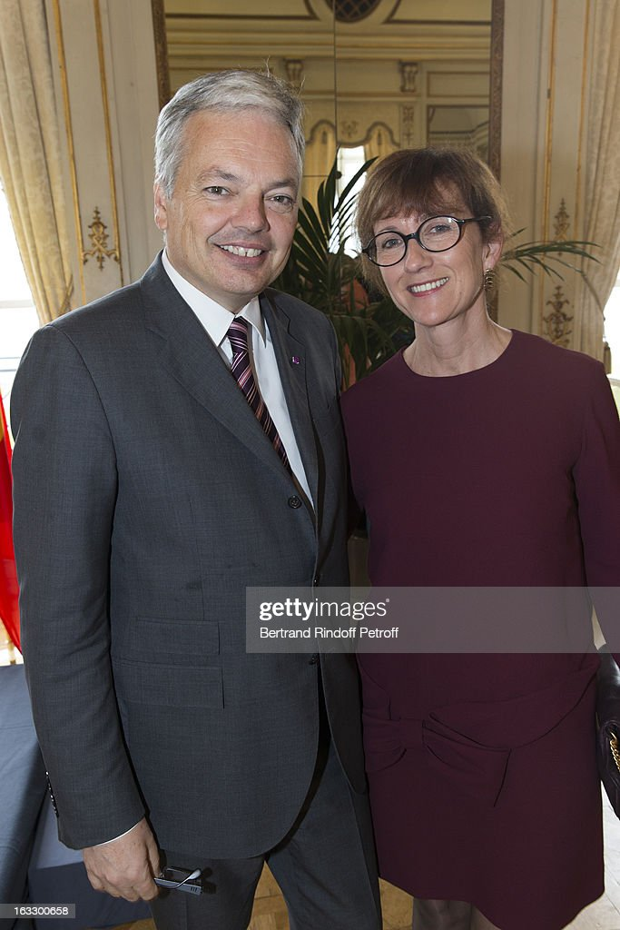 Belgian Forein Minister and Vice Prime Minister Didier Reynders (L) and his wife Bernadette pose prior French journalist and author Stephane Bern to be appointed officer in the King Leopold order during a ceremony at Palais d'Egmont on March 7, 2013 in Brussels, Belgium.
