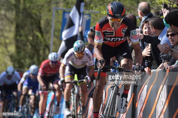 Belgian Greg Van Avermaet of BMC Racing Team rides on the Kemmelberg during the 79th edition of the GentWevelgem one day cycling race from Deinze to...