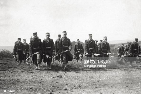 Belgian infantry troop advancing in the countryside during World War I 1914