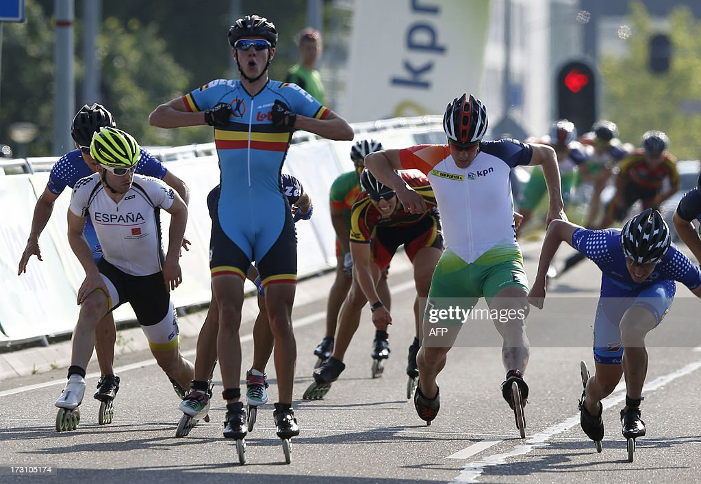 Belgian inline skater Bart Swings (2nd L) reacts after winning the marathon at the Inline skating European Championship in Almere, the Netherlands, on July 6, 2013.