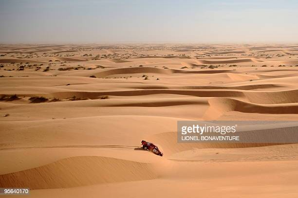 Belgian Jacky Loomans drives his Nissan during the 7th stage Boulanouar Tabenkrout Mauritania of the Africa Eco Race on January 6 2010 The Africa Eco...