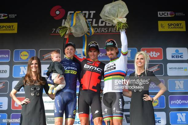 Belgian Jens Keukeleire of Orica Scott Belgian Greg Van Avermaet of BMC Racing Team and Slovakian Peter Sagan of BoraHansgrohe celebrate on the...