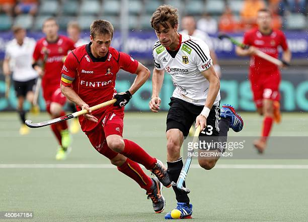 Belgian Jerome Truyens duels with Florian Fuchs of Germany during their match in the men's tournament of the Field Hockey World Cup in The Hague on...