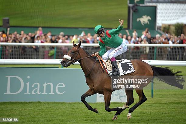 Belgian jockey Christophe Soumillon celebrates after winning the 159th Prix de Diane horse racing aboard French horse Zarkava on June 8 2008 in...