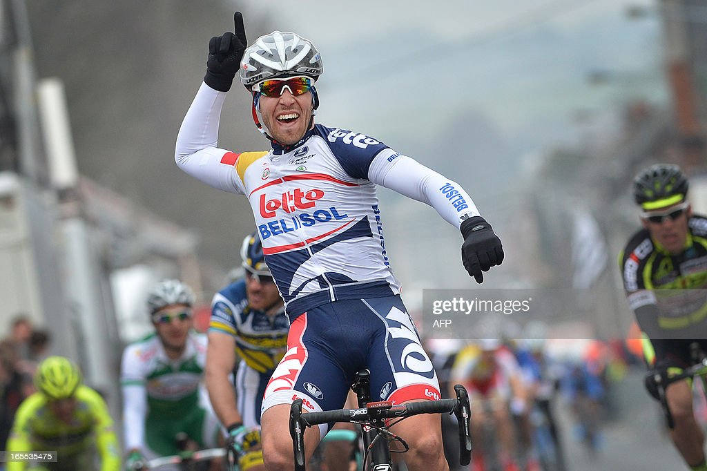 Belgian Jonas Vangenechten of Lotto - Belisol celebrates his victory as he crosses the finish line of the 47th edition of the one day cycling race 'GP Pino Cerami', from Saint-Ghislain to Frameries, on April 4, 2013.
