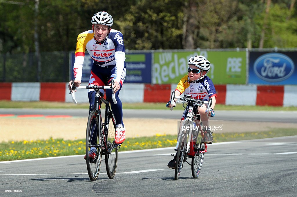 Belgian Jurgen Van Den Broeck (L) of Lotto - Belisol team rides next to his cousin Lars Van Den Broeck during the fan day of Belgian cycling team Lotto Belisol on May 4, 2013 at the race track in Zolder. AFP PHOTO / BELGA / YORICK JANSENS Belgium Out