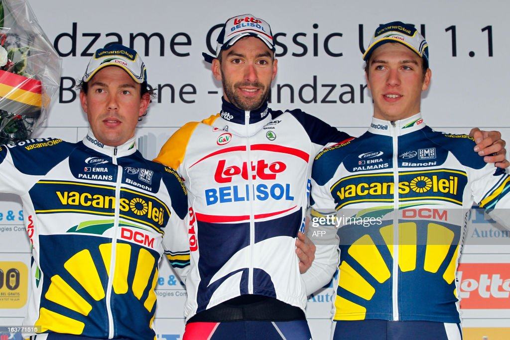 Belgian Kenny Dehaes of Lotto - Belisol (C) celebrates on the podium on March 15, 2013 with second place Dutch Kenny van Hummel (L) of team Vacansoleil-DCM and Dutch Danny van Poppel of team Vacansoleil-DCM after he won the 'Handzame Classic' cycling race in Handzame, Kortemark. AFP PHOTO / BELGA / KRISTOF VAN ACCOM