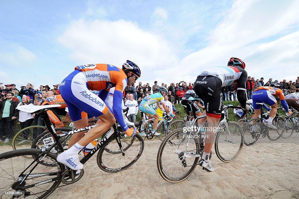 Belgian Maarten Wynants (L) of Rabobank takes a curve on a cobblestoned road during the 110th edition of the Paris-Roubaix one-day classic cycling race, on April 8, 2012, in Roubaix, northern France. Boonen, who had previously won in 2005, 2008 and 2009, equals the record of wins in Paris-Roubaix held by compatriot Roger De Vlaeminck. Boonen won the race ahead of French Sebastien Turgot (Team Europcar) and Italian Alessandro Ballan (Team BMC).