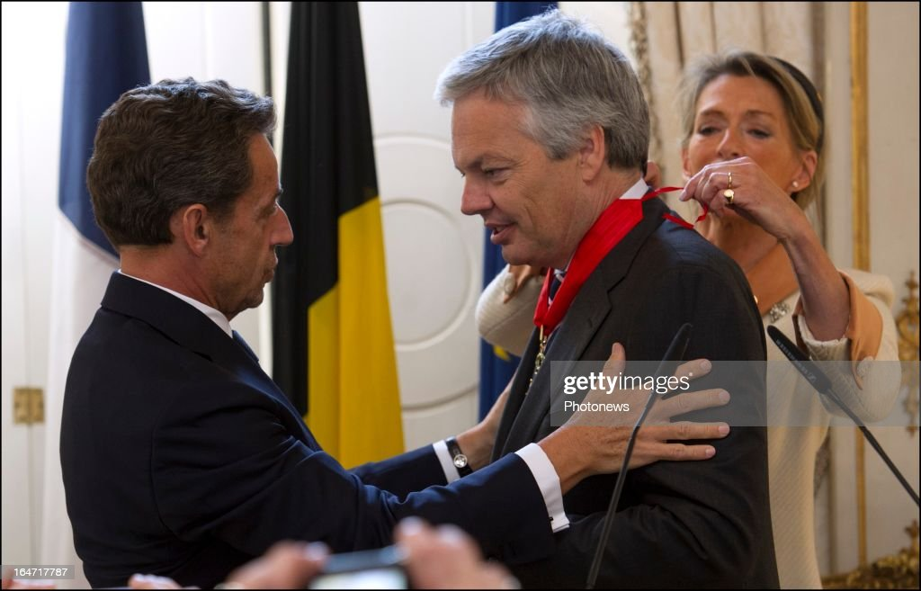 Belgian Minister of Foreign Affairs <a gi-track='captionPersonalityLinkClicked' href=/galleries/search?phrase=Didier+Reynders&family=editorial&specificpeople=548982 ng-click='$event.stopPropagation()'>Didier Reynders</a> receives the Legion d'Honneur from former French president <a gi-track='captionPersonalityLinkClicked' href=/galleries/search?phrase=Nicolas+Sarkozy&family=editorial&specificpeople=211375 ng-click='$event.stopPropagation()'>Nicolas Sarkozy</a> on March 27, 2013 in Brussels, Belgium.