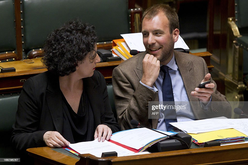 Belgian Minister of Justice Annemie Turtelboom (Open Vld Flemish liberals) and State Secretary for Energy, Mobility, Environment and State Reform Melchior Wathelet (cdH French-speaking christian democrats) speak during a plenary session of the Chamber at the federal parliament in Brussels, on May 8, 2013.