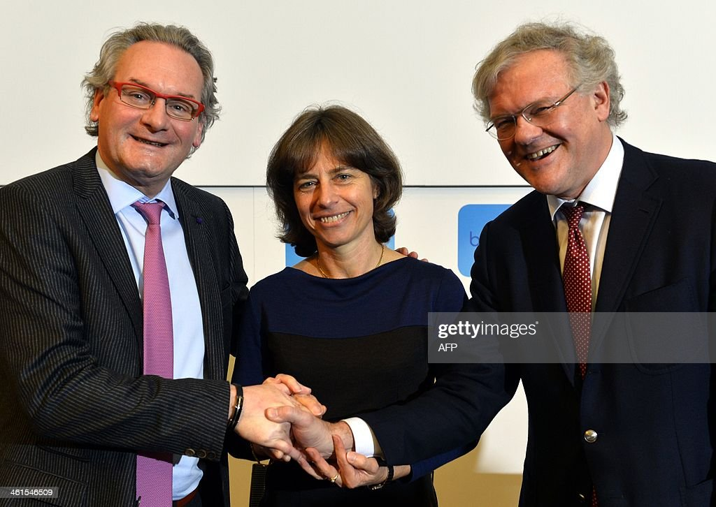 Belgian Minister of Public Enterprises and Development Cooperation Jean-Pascal Labille (PS French-speaking Socialists), CEO of Belgian telecommunications company Belgacom Dominique Leroy and Chairman of the board of directors of Belgacom Stefaan De Clerck shake hands during a press conference of the Belgacom board of directors to present the company's new CEO on January 9, 2014, at the Belgacom headquarters in Brussels. Dominique Leroy, who previously held the function of Belgacom Executive Vice-President Consumer Business Unit, is the successor of Didier Bellens, who was discharged last November.