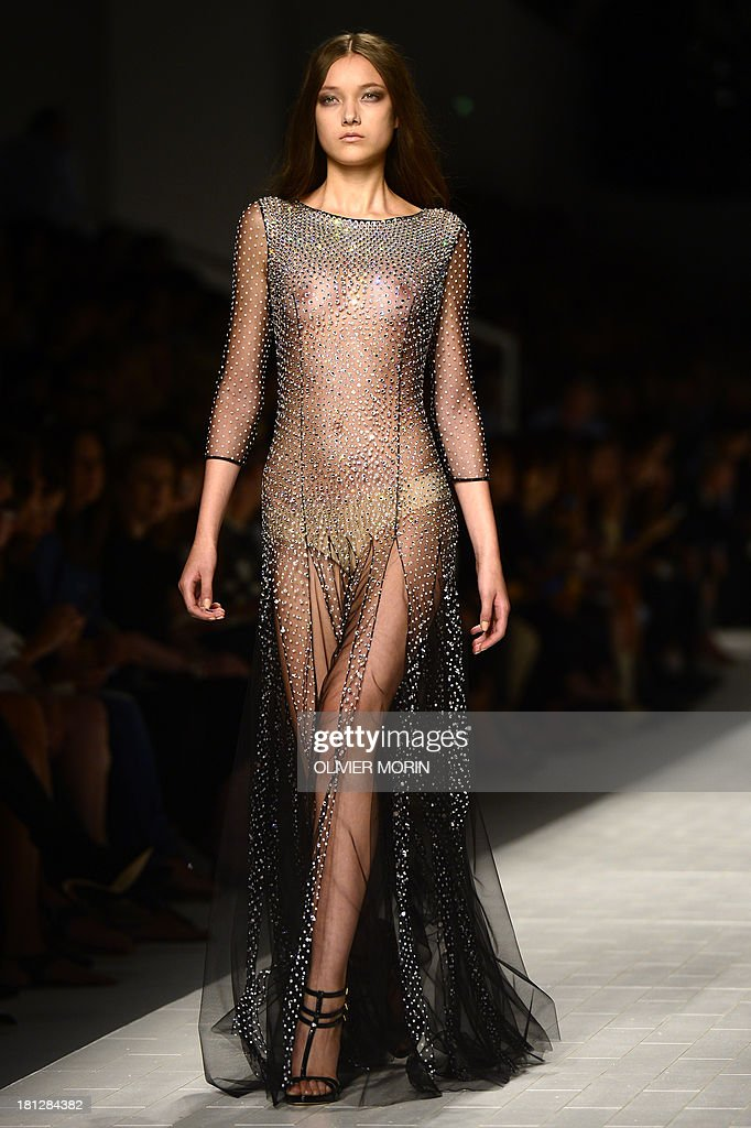 Belgian model Yumi Lambert presents a creation for fashion house Blumarine as part of the spring/summer 2014 ready-to-wear collections during the fashion week in Milan on September 20, 2013. AFP PHOTO / OLIVIER MORIN