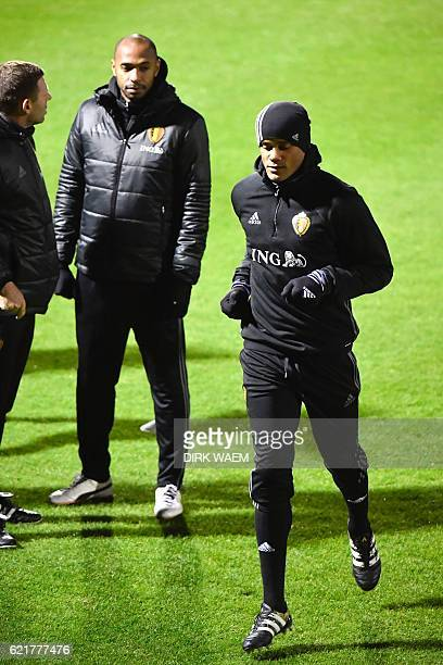 Belgian national soccer team The Red Devils assistant coach Thierry Henry and Belgium's Vincent Kompany take part in a training session on November 8...