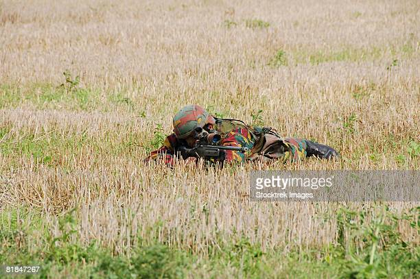 Belgian paratroopers on guard in the fields.