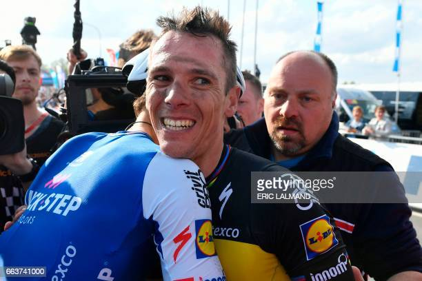Belgian Philippe Gilbert of QuickStep Floors celebrates with Dutch Niki Terpstra of QuickStep Floors after winning the 101st edition of the 'Ronde...