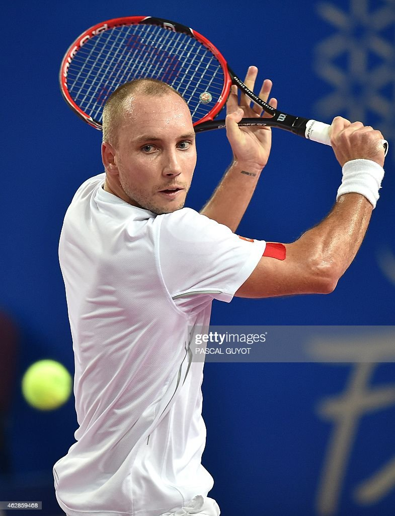 Belgian player <a gi-track='captionPersonalityLinkClicked' href=/galleries/search?phrase=Steve+Darcis&family=editorial&specificpeople=4354952 ng-click='$event.stopPropagation()'>Steve Darcis</a> returns the ball to French player Gael Monfils during their tennis match at the Open Sud de France world tour ATP on February 6, 2015 in Montpellier, southern France. AFP PHOTO / PASCAL GUYOT