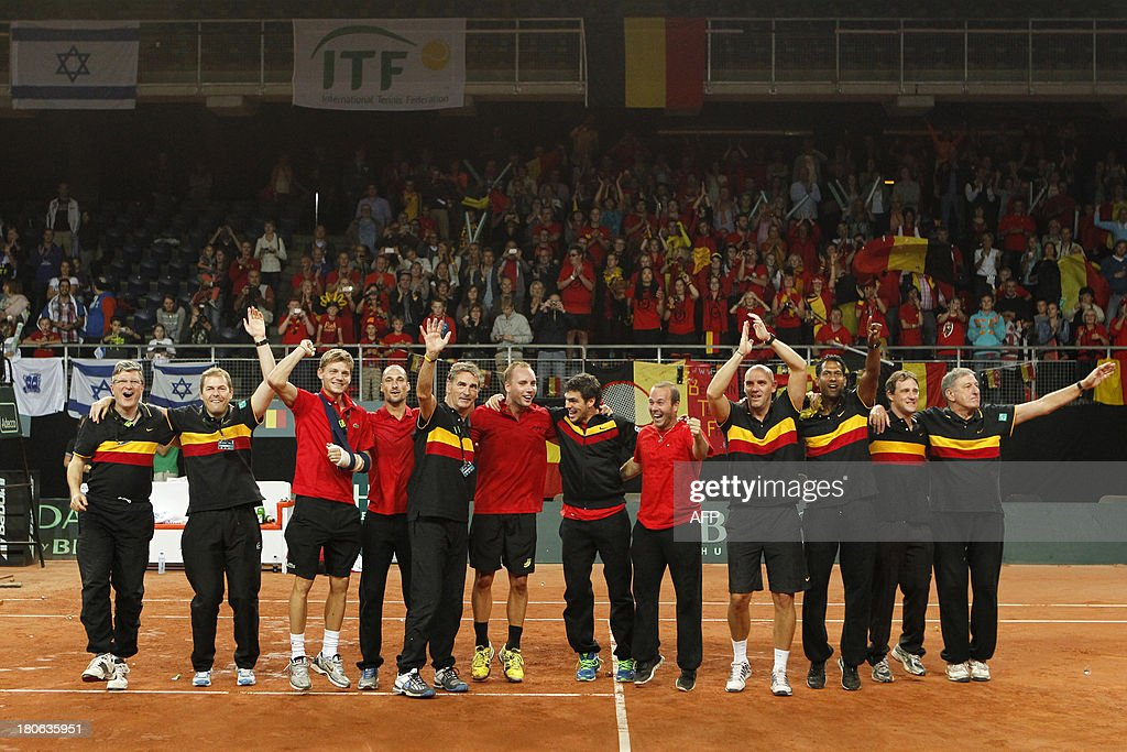 Belgian players and staff celebrate after Belgian Steve Darcis defeated Israeli Amir Weintraub on September 15, 2013 in a Davis Cup World Group play-off tennis match in Antwerp.
