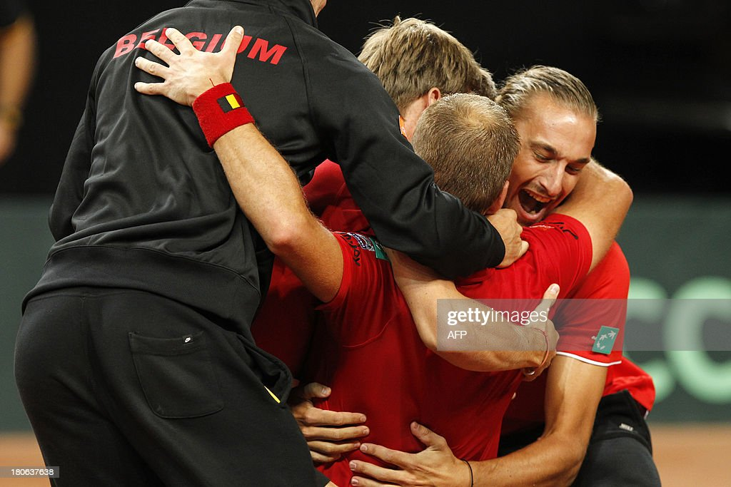 Belgian players celebrate on September 15, 2013 after Belgian Steve Darcis defeated Israeli Amir Weintraub in a Davis Cup World Group play-off tennis match in Antwerp.