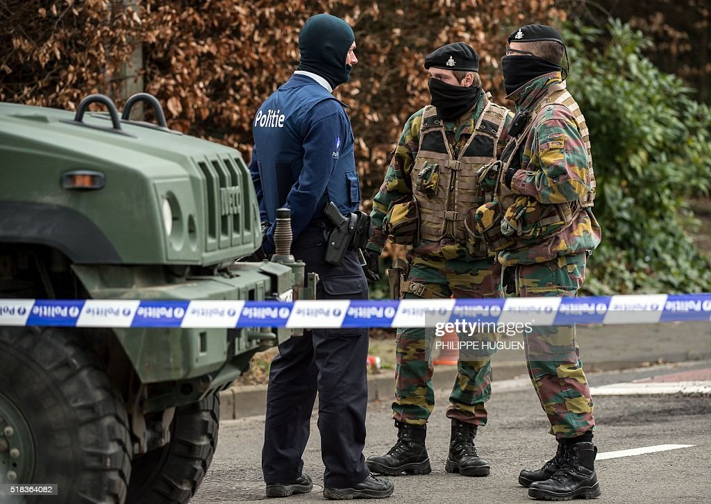 Belgian police and servicemen block access to the closed hotel and restaurant Villa Marquette on March 31 in Courtrai during an operation in...