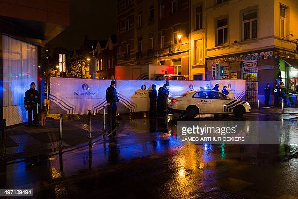 Belgian police cordon off a street during a police raid in connection with the November 13 deadly attacks in Paris in Brussels' Molenbeek district on...