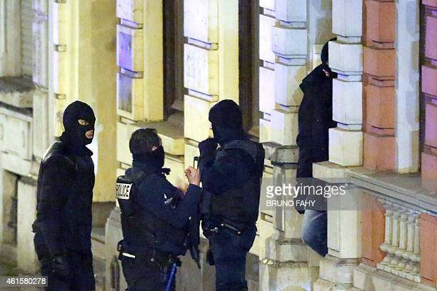 Belgian police enter a building in Palais street near Colline street in Verviers eastern Belgium on January 15 as police set a large security...