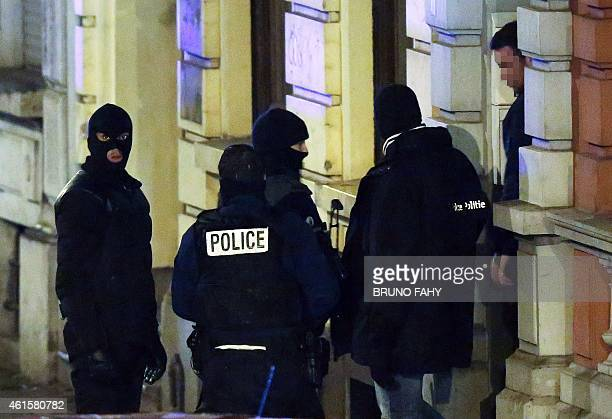 Belgian police exit a building in Palais street near Colline street in Verviers eastern Belgium on January 15 after two men were reportedly killed...