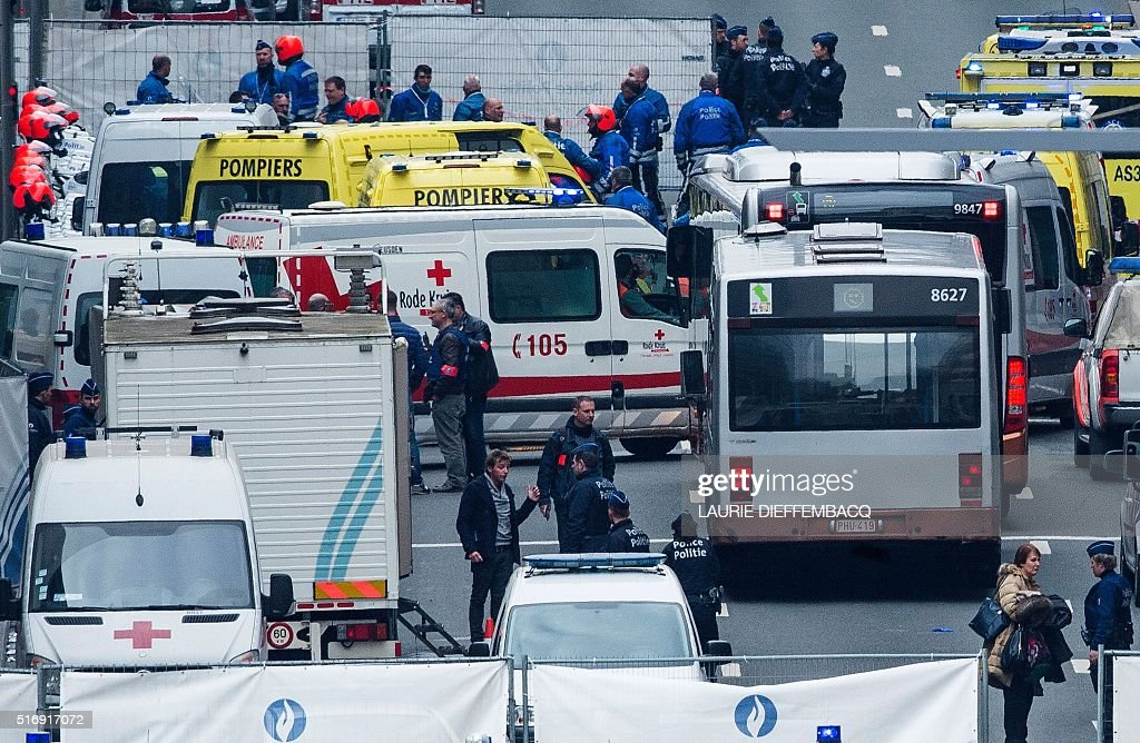 Belgian police officers and rescue workers gather on the Wetstraat which was evacuated after an explosion at the Maalbeek Maelbeek subway station in...