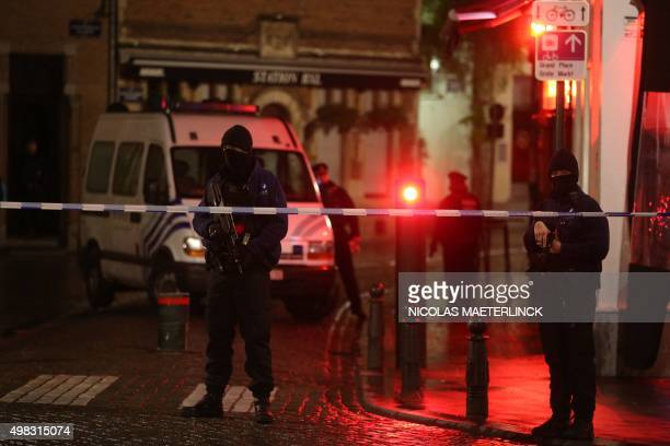 Belgian police officers secure an area in Brussels on November 22 2015 Brussels will remain at the highest possible alert level with schools and...