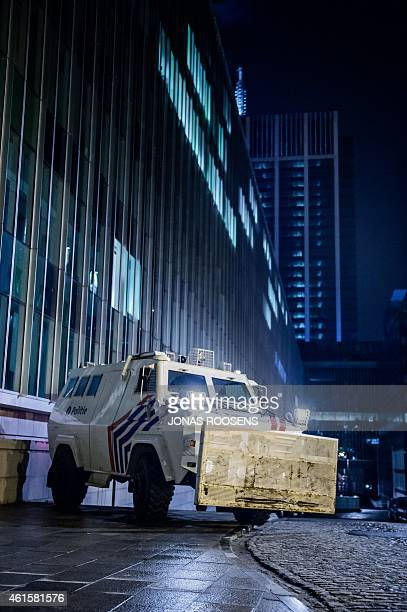 A Belgian police vehicle is stationed near the Federal police building at Congress in Brussels on January 15 2015 after Belgian police shot dead two...
