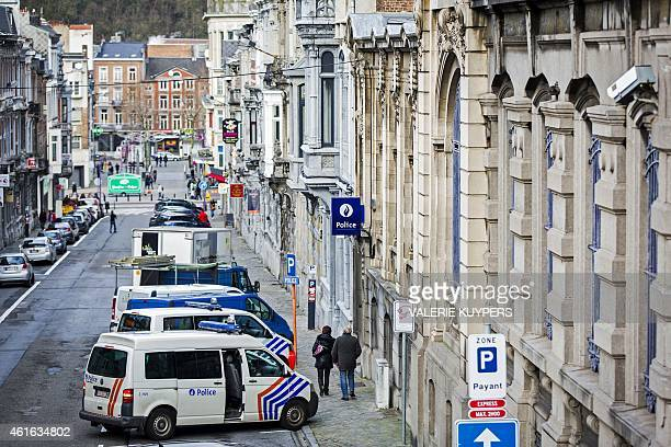 Belgian police vehicles are parked outside a police station in Verviers eastern Belgium on January 16 one day after two suspected jihadists were...