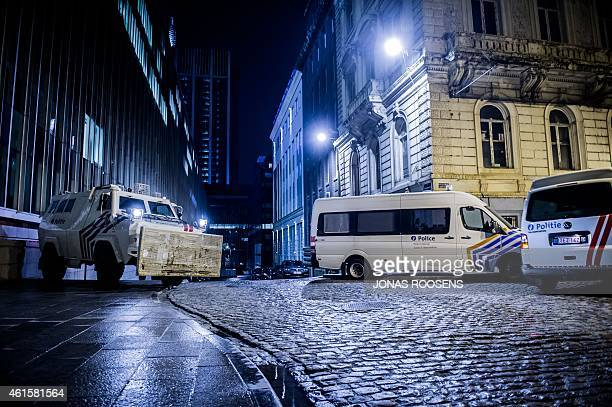 Belgian police vehicles are stationed near the Federal police building at Congress in Brussels on January 15 2015 after Belgian police shot dead two...