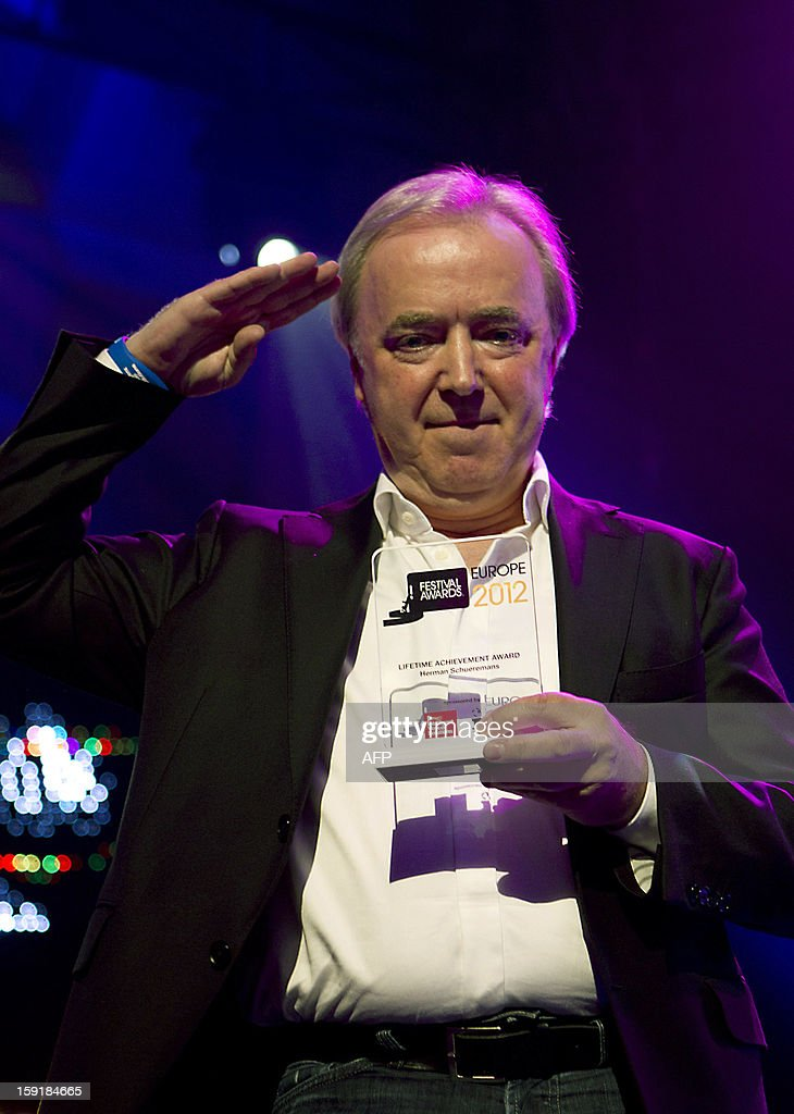 Belgian politician and concert promoter Herman Schuermans holds on January 9, 2013 the 2013 Lifetime Achievement Award during the European Border Breakers Awards ('the EBBAs'), highlighting the best new music acts in Europe which have achieved cross-border chart success, in Groningen. AFP PHOTO / ANP / KIPPA PAUL BERGEN - netherlands out -
