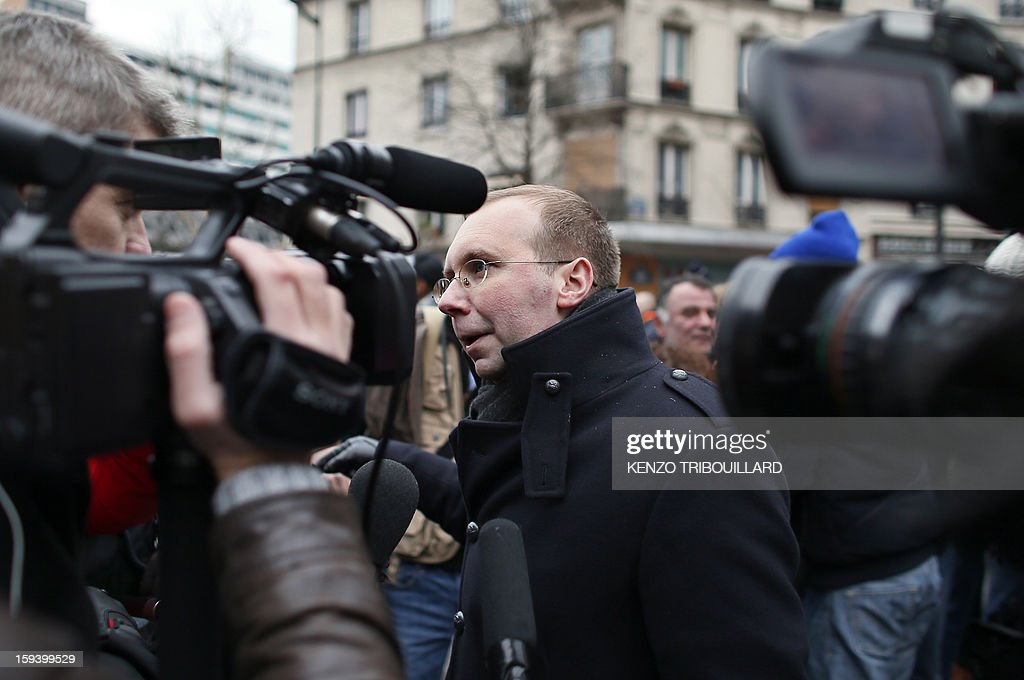 Belgian president of the French fundamentalist Christians group Civitas, Alain Escada (C) answers journalist's questions during a protest organized by Civitas Institute against same-sex marriage on January 13, 2013 in Paris. Tens of thousands march in Paris on January 13 to denounce government plans to legalise same-sex marriage and adoption which have angered many Catholics and Muslims, France's two main faiths, as well as the right-wing opposition. The French parliament is to debate the bill -- one of the key electoral pledges of Socialist President -- at the end of this month.