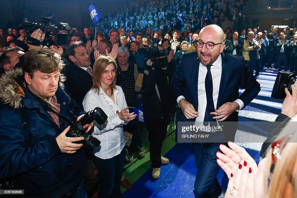 Belgian Prime Minister Charles Michel attends a May Day meeting of the French-speaking liberal Reformis Movement (MR) in Jodoigne on May 1, 2016. / AFP / Belga / BRUNO FAHY / Belgium OUT
