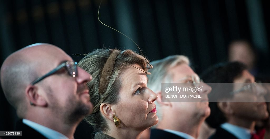 Belgian Prime Minister Charles Michel, Belgium's Queen Mathilde, Belgium's King Philippe and Mons' Mayor Elio Di Rupo during the opening ceremony of Mons 2015, European Capital of Culture, at the Sainte Waudru Cathedral in Mons on January 24, 2015. Mons is one of two cultural capitals selected by members of the European Commission for 2015, the other is Plzen, Czech Republic.