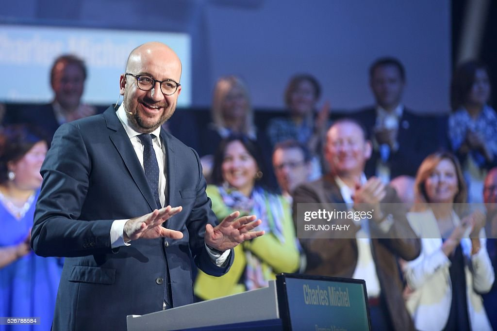Belgian Prime Minister Charles Michel delivers a speech during a May Day meeting of the French-speaking liberal Reformist Movement (MR) in Jodoigne on May 1, 2016. / AFP / Belga / BRUNO FAHY / Belgium OUT