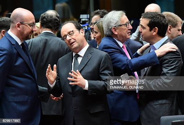 TOPSHOT Belgian Prime Minister Charles Michel French President Francois Hollande European Commission President JeanClaude Juncker and Greek Prime...