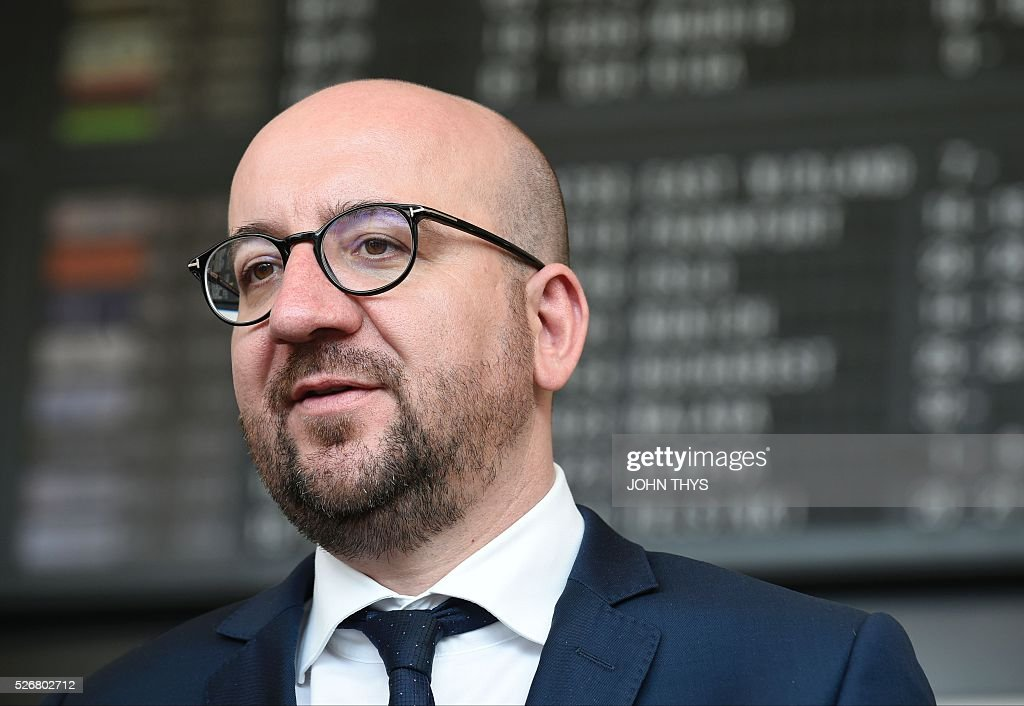 Belgian Prime Minister Charles Michel is pictured at Zaventem Airport in Brussels on May 1, 2016, during the partial reopening of the departure hall after it was badly damaged in twin suicide attacks on March 22, that killed 16 people. A total of 32 people were killed and more than 300 wounded in coordinated suicide bombings at the airport and a metro station in central Brussels on March 22 in Belgium's worst ever terror attacks. / AFP / JOHN