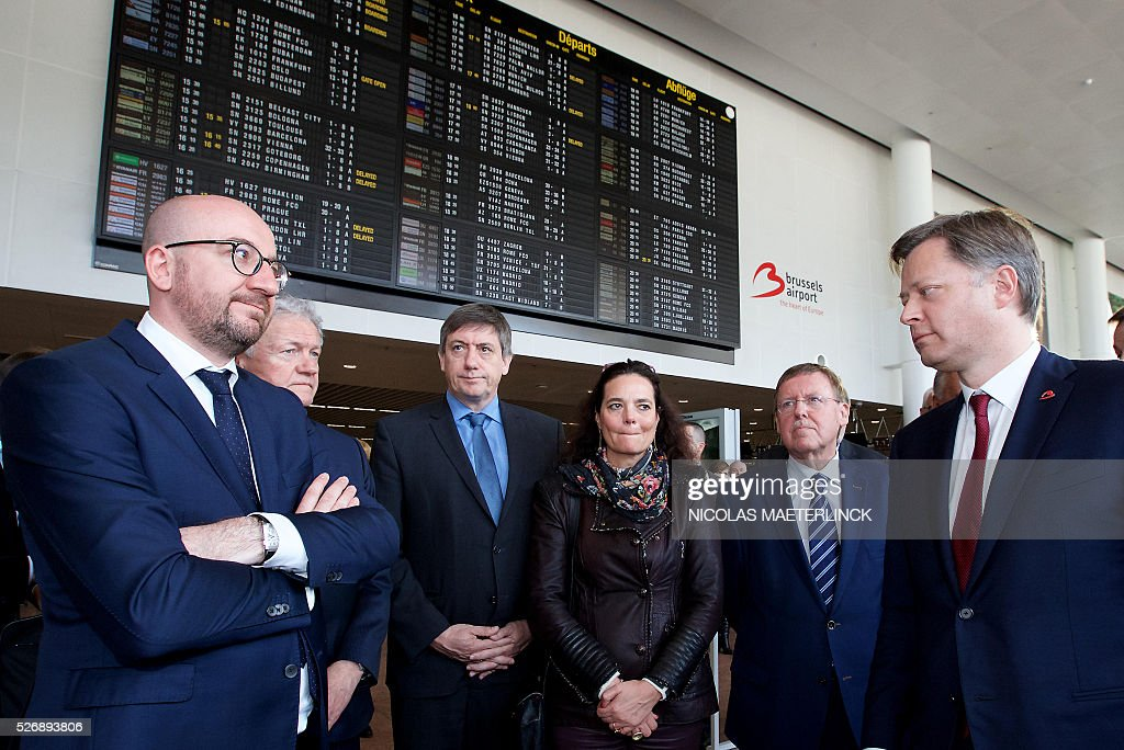 Belgian Prime Minister Charles Michel, new Minister of Mobility Francois Bellot, Vice-Prime Minister and Interior Minister Jan Jambon, Senate chairwoman Christine Defraigne, Chamber chairman N-VA's Siegfried Bracke and Brussels Airport CEO Arnaud Feist attend on May 1, 2016 the opening ceremony of the departure hall, closed since the March 22 attacks, at Zaventem airport in Brussels during Brussels airport was hit on March 22, 2016 by one of the three Islamic State suicide bombers who struck the airport and Maelbeek - Maalbeek metro station on March 22, killing 32 people and injuring hundreds. / AFP / BELGA / NICOLAS MAETERLINCK / Belgium OUT