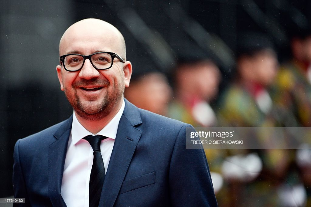 Belgian Prime Minister <a gi-track='captionPersonalityLinkClicked' href=/galleries/search?phrase=Charles+Michel+-+Homme+politique&family=editorial&specificpeople=13722663 ng-click='$event.stopPropagation()'>Charles Michel</a> smiles during a ceremony marking the 200th anniversary of the Battle of Waterloo on June 18, 2015 in Waterloo. A solemn memorial service will take place on the morning of June 18, 2015, marking the minute the first musket balls flew on the battlefield south of Brussels, followed by a huge sound-and-light show in the evening.