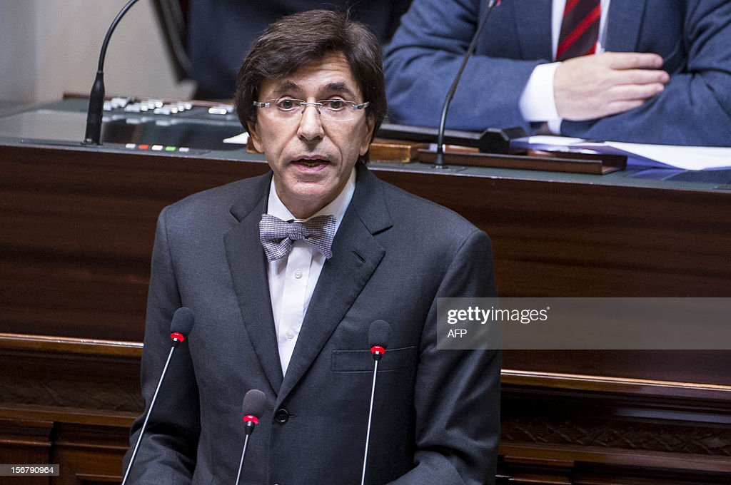 Belgian Prime Minister Elio Di Rupo addresses a plenary session of the federal parliament in Brussels on November 21, 2012, a day after his government completed 2013 budget negotiations. OUT -