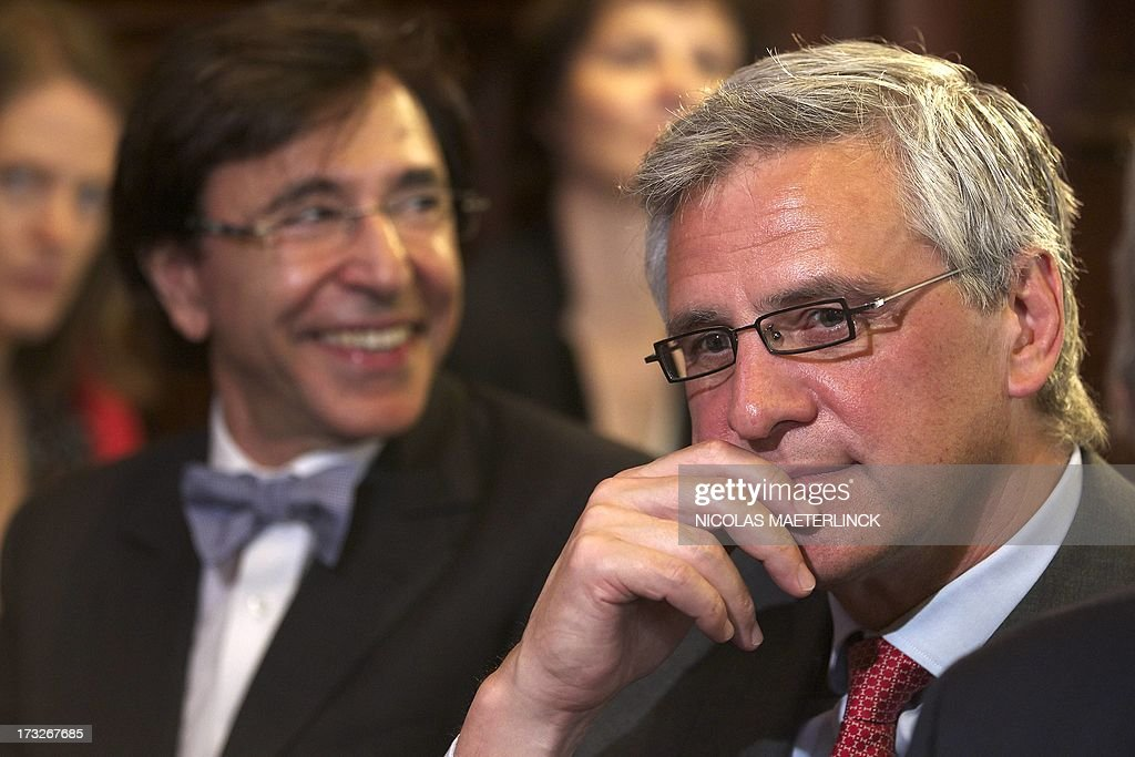 Belgian Prime Minister Elio Di Rupo (R) and Flemish Minister-President Kris Peeters (CD&V, Flemish Christian Democrats) (Back) attend the celebrations of the Flemish regional holiday, on July 11, 2013 at the city hall in Brussels. AFP PHOTO/ BELGA / NICOLAS MAETERLINCK -Belgium Out-