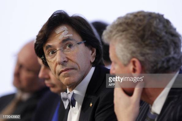 Belgian Prime Minister Elio Di Rupo and VicePrime Minister and Defence Minister Pieter De Crem give a press conference after a Kern meeting a...
