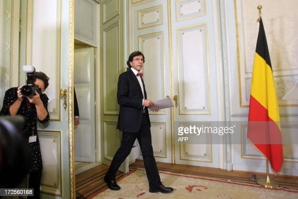 Belgian Prime Minister Elio Di Rupo arrives for a press conference after a Kern meeting a restricted ministers meeting at the Prime Minister's office...