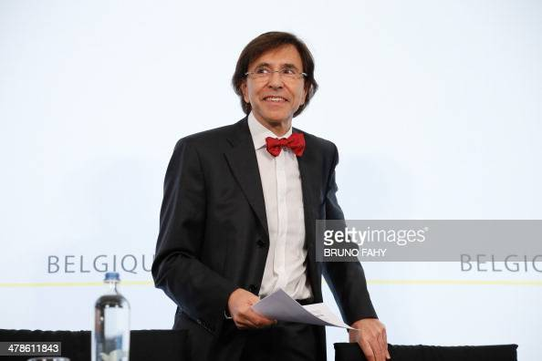 Belgian Prime Minister Elio Di Rupo arrives to hold a press conference after a ministers meeting at the Prime Minister's office in Brussels on March...